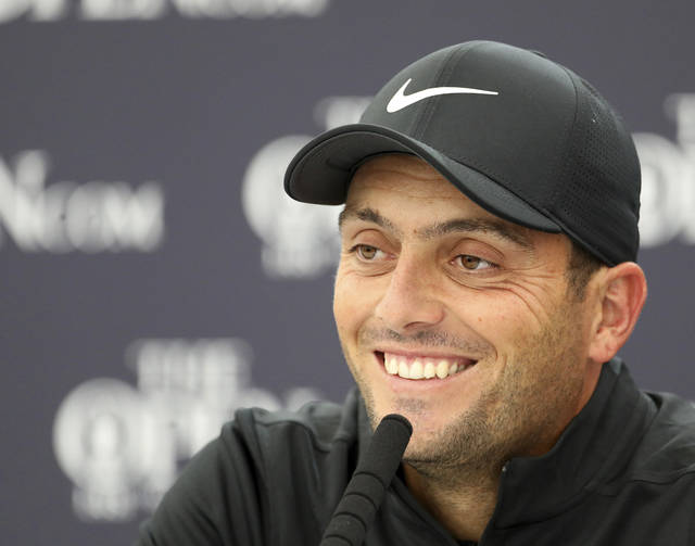 2018 Open winner Francesco Molinari of Italy talks to the media during a press conference at Royal Portrush Golf Club, Northern Ireland, Monday, July 15, 2019. The148th Open Golf Championship begins on July 18. (AP Photo/Peter Morrison)