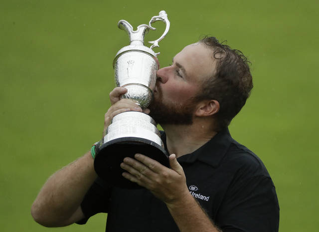 Ireland's Shane Lowry holds and kisses the Claret Jug trophy after winning the British Open Golf Championships at Royal Portrush in Northern Ireland, Sunday, July 21, 2019.(AP Photo/Matt Dunham)