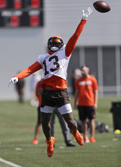 Cleveland Browns wide receiver Odell Beckham Jr. reaches but can't get to a pass during practice at the NFL football team's training camp facility, Thursday, July 25, 2019, in Berea, Ohio. (AP Photo/Tony Dejak)