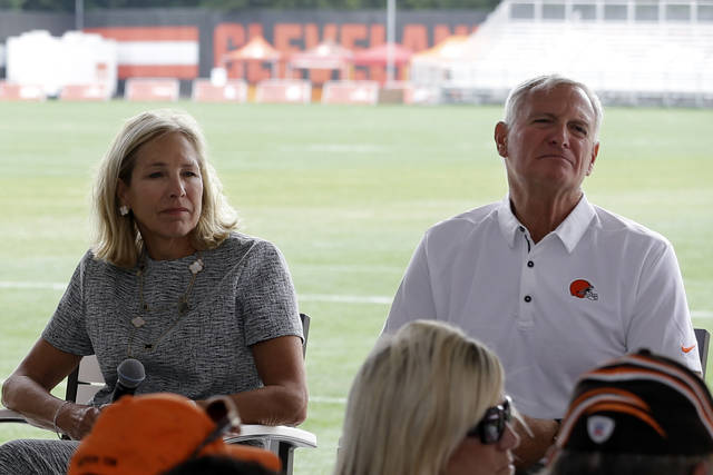 FILE - In this Aug. 17, 2017, file photo, Cleveland Browns owners Dee and Jimmy Haslam listen to a question during a season ticket member fan forum before practice at the NFL football team's training facility in Berea, Ohio. With their team predicted to contend for a Super Bowl title, Browns owners Dee and Jimmy Haslam are expected to discuss the enormous expectations, Sunday, July 28, 2019, at training camp (AP Photo/Tony Dejak, File)