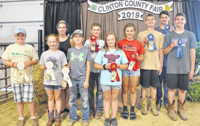In Livestock Judging at the 2019 Clinton County Fair, from left are Juniors Wade Smith, Samantha Woodruff, Emery Pauly, Fair Princess Carrie Robinson, Taylor Barton, Hunter Schumaker, Sidney Schieder, Caleb Brown, Andrew , and Bradley.