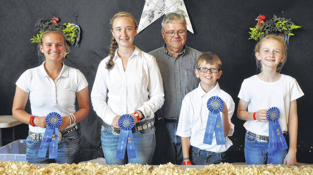 In Fancy Poultry Showmanship, champions are, from left: Senior — Hailey Fugate; Intermediate — Logan Schumaker; Junior — Wyatt Philpot; and Beginner — Mallory Thomason.