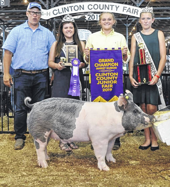 The 2019 Clinton County Fair Grand Champion Market Hog goes to Kennedy Thompson. Shown are Judge Kevin Wendt, Pork Ind. Queen Samantha Achtermann, Thompson, and Pork Ind. Princess Emmy Chambliss.