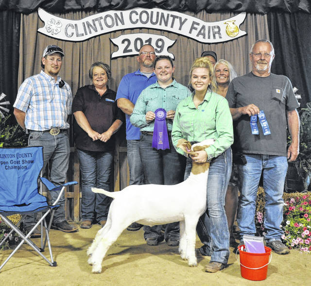 Open Goat Show winner is Kyle Price, shown with Wyatt Fyffe and Sherri Keller of the Senior Fair Board, Judge Bill Pegan, Ashlie Hillyer, and Angel and Jim Mootz.