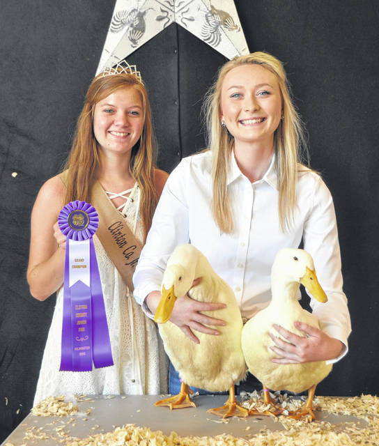 Grand Champion Market Duck winner is Madison Gilbert, with Poultry Queen Darcie Zeckser.