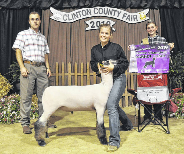 Market Sheep Reserve Champion is Gabbie Crogan, shown with Judge Jordan Amburgey and Lamb & Fleece Queen Paige Bowman.