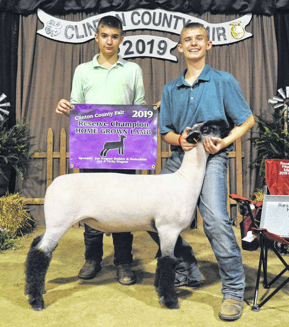 For Reserve Champion Home Grown Lamb are Caleb Brown with Bradley Brown.
