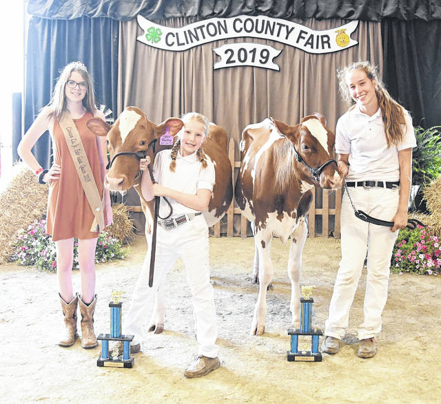 From left are Jr. Fair Goat Queen Mackenzie Osborne, Jr. Supreme Overall Reserve Champion Shelby Leaming, and Jr. Supreme Overall Champion Caili Baumann.