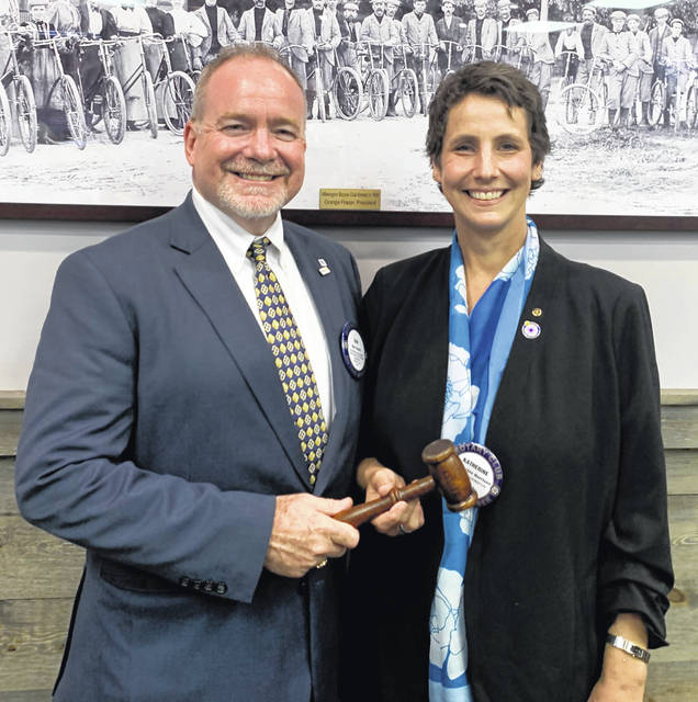 Dan Evers, Past President of the Wilmington Rotary Club, passing the gavel to Katherine Harrison-Tigar, Incoming President of the Wilmington Rotary Club.