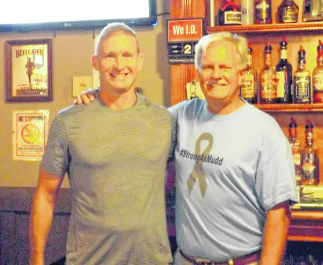 Michael Noszka and Ron Rudduck were celebrity bartenders last week at MacD's Pub for the Strong As Mudd book signing and benefit dinner. Noszka, the former Wilmington High School boys basketball coach, has been a rival and now a friend to Mudd. Rudduck, a WHS graduate, was Mudd's former boss but more importantly a companion on many medical trips related to Mudd's battle with brain cancer.