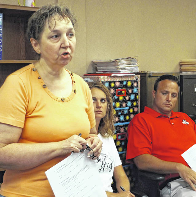 Stephanie Evans, left foreground, urges East Clinton officials to continue offering Family and Consumer Sciences courses.
