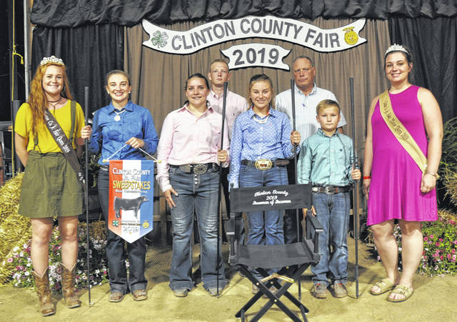 In Beef Showmanship, from left are Fair Queen Myah Jones with winners: Senior — Delaney Schneder, also Sweepstakes Representative; Intermediate — Liz Schiff; Junior — Sydner Schneder; Beginner — Carson Barton; with Judges Rick Davis & Dalton Davis and Horse Queen Nicole Longenecker.
