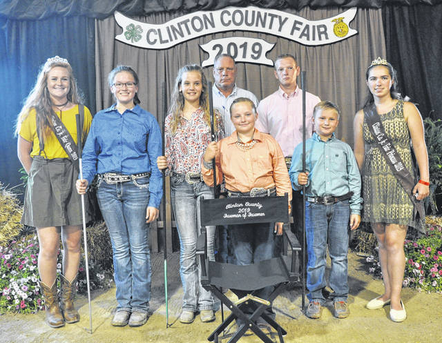In the Feeder Calf category, from left are Fair Queen Myah Jones with: Senior — Hailey Dean; Intermediate — Emmie Danku; Junior — Taylor Barton, also Showman of Showmen; Beginner — Carson Barton;	Judges Rick Davis & Dalton Davis; and Fair Princess Carrie Robinson.