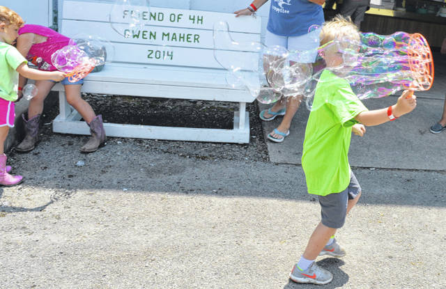 On Monday through Friday of fair week, an activity is held 2 p.m. on the fairgrounds for Cloverbuds (youngsters 5 to 8). On Tuesday, it was time to make and chase and burst bubbles.