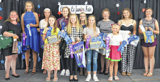 These are the first-place winners in the Style Review & Clothing Awards event Sunday at the county fair in the Peterson Building. From left in the front row are Annamae Huddleston, Kensey Parker, Addison Swope and Lilly Pinkerton; and from left in the back row are Jenna Allemang, Lexus Reiley, Carrie Robinson, Courtney Parker, Family & Consumer Sciences Queen Lexi Arehart McBrayer, Anna Garnai, Liza Duncan and Jenna Hanlon.