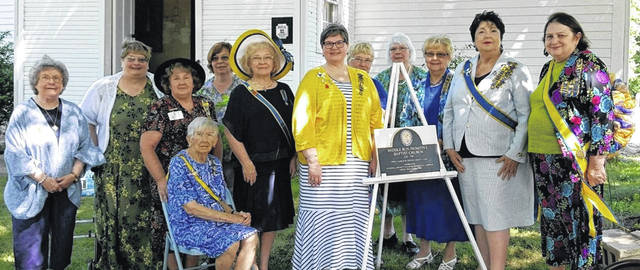 From left are: Mary Ann VanTress; Leslie Holmes, Chaplain; Kay McIntire, Ohio Society Registrar & Chapter Vice President; Grace Yerian, Honorary Past State President; Susan Henry, Ohio Society Membership Chair & Chapter Recording Secretary; Janice O'Neil, Ohio Society State President; Kim Stackhouse, Ohio Society Corresponding Secretary, Chapter President & Historic Site Marking Chair; Nancy Bernard, Chapter Corresponding Secretary; Linda Lee, Ohio Society Heraldry & Coats of Arms Chair; Frances Sharp, Ohio Society Historic Site Marking Chair & Chapter Registrar; Yvonne Hiteshue, National Society Curator General, State Parliamentarian & Honorary Past State President; and Carolyn Jones Hall, National Chair of Conference Committees & Honorary Past State President. Not pictured is Kathy Foust, State Society Librarian.