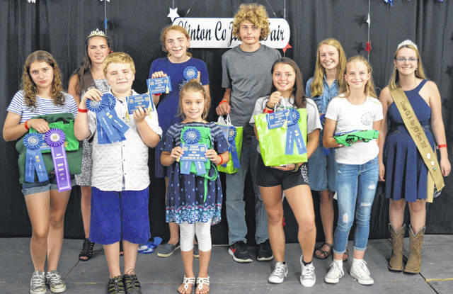 Here are cooking-related winners in the Family & Consumer Sciences (FCS) / General Awards event Sunday as part of the Clinton County Junior Fair. From left in the front row are Danica Henderson, Owen Koch, Mileigh Hollingsworth, Leesha Cox and Addison Swope; and from left in the back row are Clinton County Junior Fair Princess Carrie Robinson, Carolyn Koch, Dallas Harner, Allie Houseman, and Clinton County Junior Fair FCS Queen Lexi Arehart McBrayer.