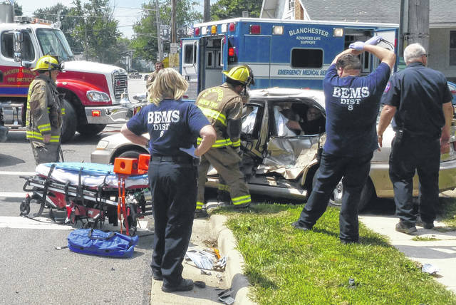 """Blanchester police were called to the intersection of Center and Broadway streets to investigate a traffic crash at around 12:45 p.m Monday. Ptl. Sarah Luken found that two cars involved in the crash, a blue Dodge SUV and a tan Honda sedan, with the driver trapped inside the Honda, according to Police Chief Scott Reinbolt. He said Blanchester Emergency Medical Service and the Blanchester-Marion Township Fire District responded to the scene and fire personnel were able to extricate the driver from the Honda, who was transported to Clinton Memorial Hospital via ambulance. """"Preliminary results of the investigation indicate the Honda was traveling northbound on Broadway Street, ran a red traffic light, and was struck in the intersection by the eastbound Dodge SUV,"""" stated Reinbolt."""