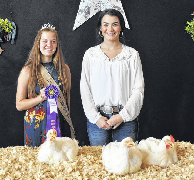 The Grand Champion Meat Pen-Of-Three winner is Bradeanna Arehart, right, shown with Queen Darcie Zeckser.