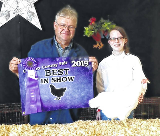 Fancy Poultry Best Of Show & Overall Female Bird champion is Alyssa Hutchinson, shown with Judge Dr. Rick Bokanyl.