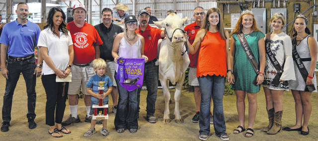 The Grand Supreme Champion Cow exhibited by Maggie Mathews of the New Vienna area garnered $1,700 at the Clinton County Junior Fair livestock sales. The buyers are ABX Air, American Equipment Service, Bush Auto Place, Emma Mathews Photography, First State Bank, In Memory of Gary Quallen, LT Land Development, Lowe's, No. 1 China Buffet, Nationwide Insurance Justin Holbrook, New Horizon Farm & Dairy, Ohio Dairy Magazine, Prengers, R&R Tool, Rob's Equipment, Sunrise Cooperative, W.A. Hodson Inc., Wilmington Auto Center - Chrysler, Dodge, Jeep, RAM, the Wilmington Lions Club, and Wilmington Savings Bank.