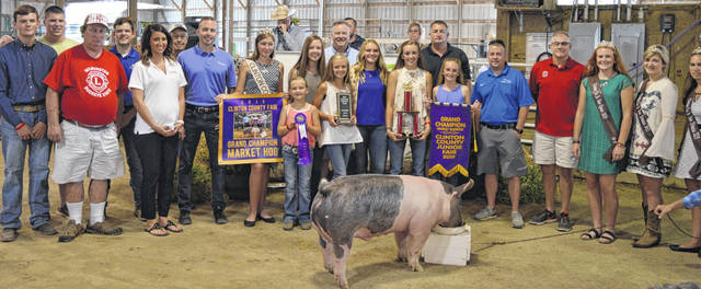 The Grand Champion Market Hog raised a $6,375 premium for exhibitor Kennedy Thompson of the Wilmington area on Saturday at the Clinton County Junior Fair livestock sales. The buyers are ATSG (Air Transport Services Group), Accurate Soils, Ag-Pro, AgriGold Hybrids, American Equipment Service, Arehart-Brown Funeral Service, Bane-Welker Equipment, Baughman Farm Excavating, Bush Auto Place, CM Farms, Dave Campbell Insurance, Cherrybend Pheasant Farm / Ellis Farms, Clinton County Auditor, Clinton County Board of Realtors, Collett Farms / Pioneer Seeds, Country View Pet Hospital / Dr. Jill Thompson, D&E Equipment Company, Diels Family, Beth and Matt Ellis, Farm Credit Services, Greater Tomorrow Health, Groves Tire & Service, Johnson Durocs, LGSTX Services, Long's Pharmacy, Lowe's, MFA Inc., MLM / Genter, Bill Marine Ford, Master Feed Mill in Wilmington, Merchants National Bank, Murphy Family, Murphy Farms, Peelle Law Offices, Peoples Bank, R+L Carriers / Roberts Centre, R.D. Holder Oil, Sams Meats, Brady and Donna Snyder, Sunrise Cooperative, Thompson Farms Show Feed, Vital Fitness, Wilmington Lions Club, Wilmington Savings Bank, and the World Equestrian Center.