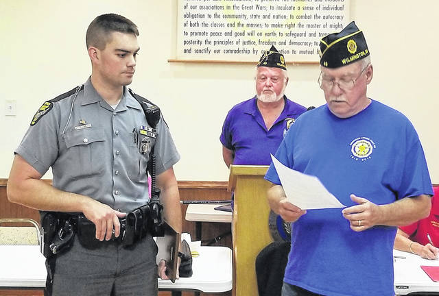 Ohio State Highway Patrol Trooper Kyle Prose has been selected as the American Legion Post 49 Law Enforcement Officer of the Year. Trooper Prose is assigned to the Wilmington State Highway Patrol Post. Presenting him with his plaque is Past Adjutant Brady Stevens.