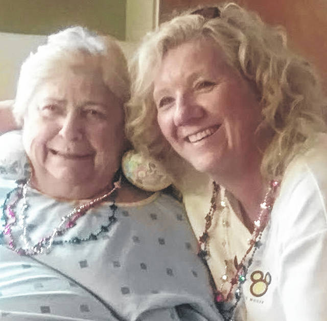 Clinton County Community Action staff recently distributed Fourth of July necklaces to residents at Wilmington Nursing and Rehab.