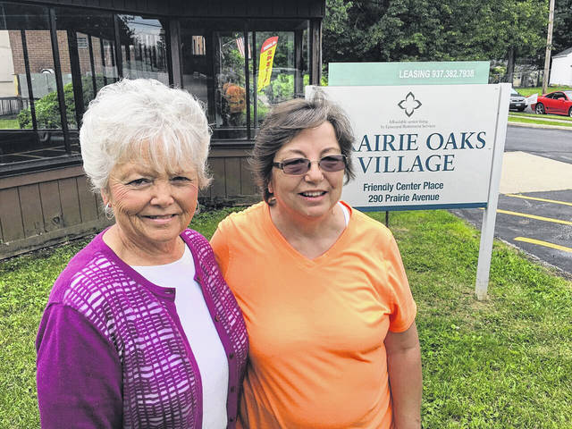 Prairie Oaks Community Manager Hazel Blomer, left, with resident Toni Kirsch.