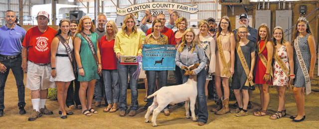 The Reserve Champion market goat exhibited by Kylie Price of the Lynchburg area collected $3,600 at the Clinton County Junior Fair livestock sales. The buyers are ATSG (Air Transport Services Group), American Equipment Service, Bronson Door Company, Carrington Farm Supply, Chris Collett Trucking, Culberson Family, Thurston and Mandy Curry, Diels Family, Emily Brautigam, Fayetteville Hardware, First State Bank, Fox Towing & Truck Service, Gibbs Insurance Associates, Groves Tire & Service, Hess Auction Company, Kendall and April Houk Farms, Lewis Financial Group, Linehaul Heavyduty, Lowe's, Melvin Stone Company, Mootz Trucking, Panetta Excavating, Parks Livestock, Peterbilt of Cincinnati, Amy and Justin Smith / Dennis McDannell, V.I.P. Quality Construction & Property Maintenance, Wilmington Lions Club, and Wilmington Savings Bank.