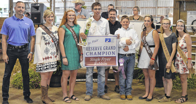 The Reserve Champion rabbit exhibited by Jace Doyle of the Port William area sold for $825 in the Clinton County Junior Fair livestock sales. The buyers are ABX Air, American Equipment Service, American Showa, Bower Family Farms, Bush Auto Place, Diverse Building Solution, Groves Tire & Service, Master Feed Mill in Wilmington, Melvin Stone Company, No. 1 China Buffet, Rob's Equipment, Skyline Chili in Wilmington, Wilmington Auto Center - Chrysler, Dodge, Jeep, RAM, and the Wilmington Savings Bank.