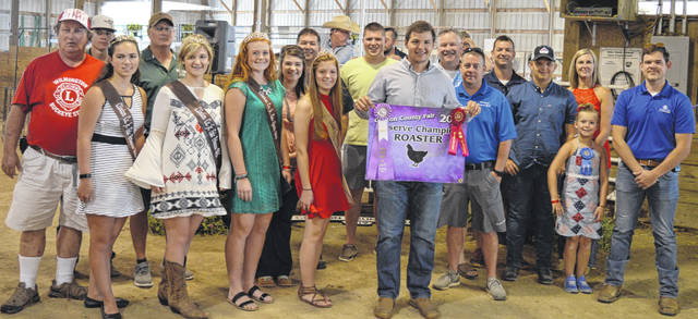 The Reserve Champion roaster exhibited by Brady Bergefurd of the Wilmington area sold for $1,150 at the livestock sales of the Clinton County Junior Fair. The buyers are American Equipment Service, American Showa, Arehart-Brown Funeral Services, BDK Feed & Supply, Bronson Door Company, CM Farms, Clinton Animal Care Center, Collett Propane, Culberson Family, Emily Brautigam, First State Bank, Groves Tire & Service, Imagine That Tool Rental, LCNB National Bank, Lewis Financial Group, Melvin Stone Company, Merchants National Bank, Miller Farms & Trucking, Peoples Bank, Smith Farms Trucking, State Farm Insurance, Vital Fitness, Williams Landscaping, Wilmington Auto Center - Chrysler, Dodge, Jeep, RAM, the Wilmington Lions Club, and WyldFyre Farms.