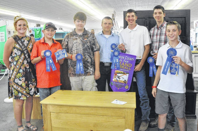 Woodworking champions at the fair are, with Queen Myah Jones, Caden Smith, Landon Dean, Cody Kidd, Tim Ritchey, and Jacob Ritchey.