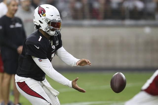Arizona Cardinals quarterback Kyler Murray takes a snap of a football during an NFL training camp Wednesday, July 31, 2019, in Glendale, Ariz. (AP Photo/Ross D. Franklin)