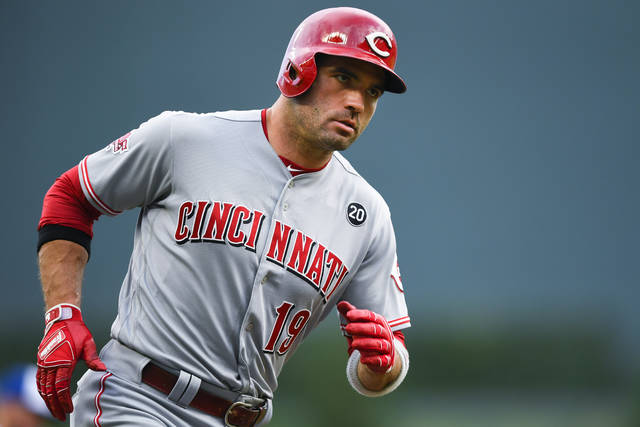 Cincinnati Reds' Joey Votto rounds third base on his two-run home run during the first inning of the team's baseball game against the Atlanta Braves, Friday, Aug. 2, 2019, in Atlanta. (AP Photo/John Amis)