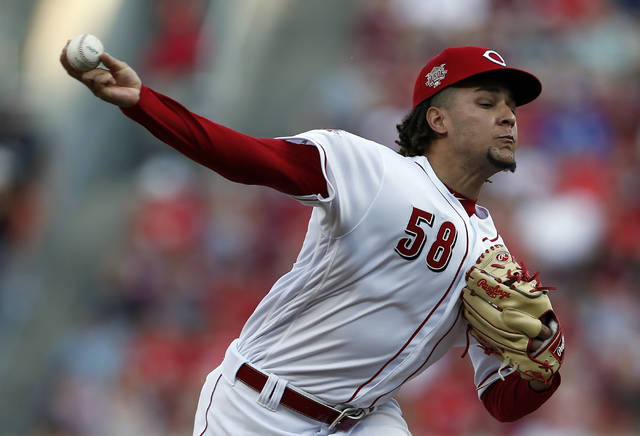 Cincinnati Reds starting pitcher Luis Castillo throws against the Los Angeles Angels during the first inning of a baseball game, Monday, Aug. 5, 2019, in Cincinnati. (AP Photo/Gary Landers)