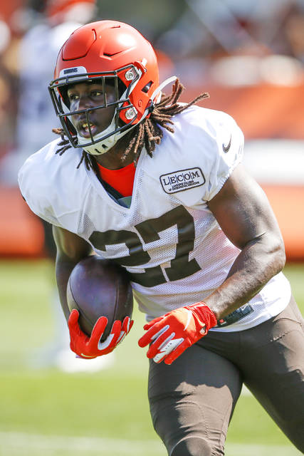 Cleveland Browns running back Kareem Hunt runs the ball during practice at the NFL football team's training facility Monday, Aug. 5, 2019, in Berea, Ohio. (AP Photo/Ron Schwane)