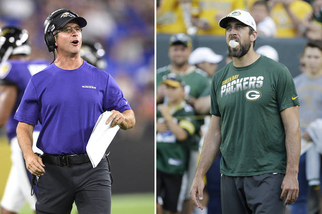 FILE - At left, in an Aug. 8, 2019, file photo, Baltimore Ravens head coach John Harbaugh talks to his team during the first half of an NFL football preseason game against the Jacksonville Jaguars in Baltimore. At right, also in an Aug. 8, 2019, file photo, Green Bay Packers quarterback Aaron Rodgers blows bubbles with his gum before the start of an NFL preseason football game against the Houston Texans in Green Bay, Wis. The Ravens will see a little bit of Aaron Rodgers on Thursday night, Aug. 15 in their preseason game. (AP Photo/File)