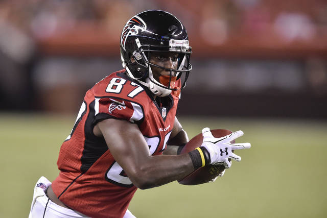 FILE - In this Aug. 18, 2016, file photo, Atlanta Falcons wide receiver Devin Fuller runs the ball in the second half of an NFL preseason football game against the Cleveland Browns in Cleveland. Fuller got his first taste of the NFL's business side during his rookie minicamp. One of the receiver's would-be teammates had a bad practice. Not much later, that player got pulled out of a meeting. Not much after that, the player was no longer Fuller's teammate. (AP Photo/David Richard, File)