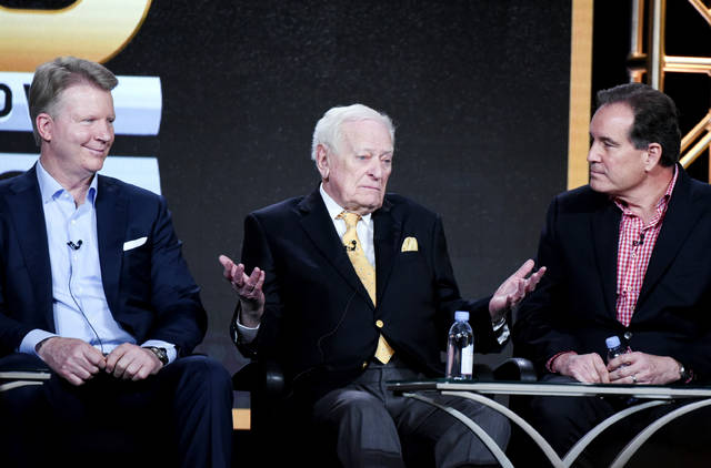 "FILE - In this Jan. 12, 2016, file photo, from left to right, sportscasters Phil Simms, Jack Whitaker and Jim Nantz participate in the ""CBS Sports"" panel at the CBS 2016 Winter TCA in Pasadena, Calif.  Whitaker, whose Hall of Fame broadcasting career ranged from the first Super Bowl to Secretariat's Triple Crown to short essays from major sporting events, died Sunday, Aug. 18, 2019, CBS reported. The network said Whitaker died of natural causes in his sleep in Devon, Pa. He was 95. (Photo by Richard Shotwell/In vision/AP, File)"