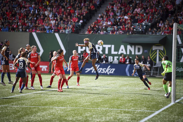 FILE - In this Sept. 22, 2018, file photo, North Carolina Courage's Jessica McDonald (14) heads the ball on goal during the team's NWSL soccer championship game against the Portland Thorns in Portland, Ore. Portland drew a league-record 25,218 fans to a game against the defending league champion North Carolina Courage earlier this month, evidence of a World Cup bump. In addition to bringing in new fans, players want sustained growth and stability. The key is investment. (Adam Lapierre/The Oregonian via AP, File)