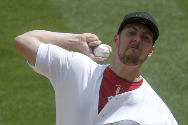 Cincinnati Reds starter Trevor Bauer pitches against the Pittsburgh Pirates in the first inning of a baseball game, Sunday, Aug. 25, 2019, in Pittsburgh. (AP Photo/Keith Srakocic)