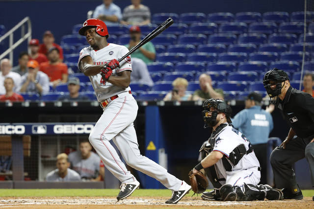 Cincinnati Reds' Aristides Aquino hits a double during the fourth inning of a baseball game against the Miami Marlins, Wednesday, Aug. 28, 2019, in Miami. The Reds defeated the Marlins 5-0. (AP Photo/Wilfredo Lee)
