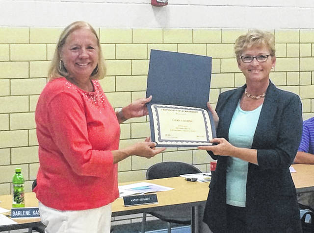 Blanchester School Board Member Kathy Gephart, left, recognized Andrea Harpen, the recipient of the Ohio Department of Education District 10 Teacher of the Year at Monday's School Board meeting. Harpen is chemistry and physics teacher at Blanchester High School.