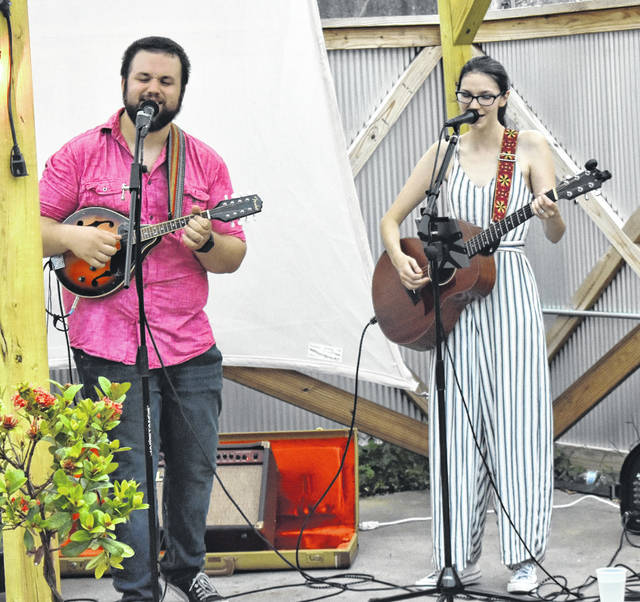 Brandon Semler, left, and Jackie Goff, of the Austin, Texas-based band Westerly Station, perform a variety of covers and original tunes at TinCap in Wilmington on Thursday.