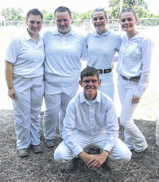 Katelyn Whitt, Alison Carson, Cora Shattuck, Destiny Waldron and Matthew O'Neill after showing in the Dairy Cattle Show at the Clinton County Fair.