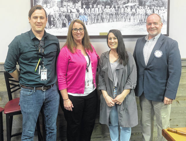 From left are: Jesse Littleton, Director of Sales & Marketing, Michelle Schrader, Chief Operation Officer, and Stephanie Piantanida, Chief Compliance Officer of Ancient Roots; and, Dan Evers, Past President of Wilmington Rotary.