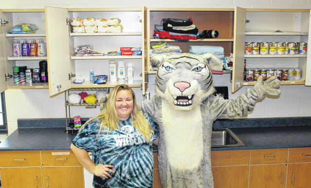 Blanchester High School teacher Jenny Hartman and her Wildcat friend with some items collected so far for the pantry.