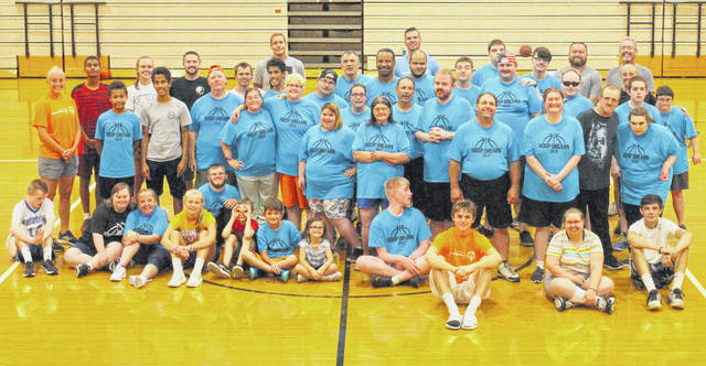 Campers and volunteers at the 13th annual Roberta Naylor Hoop Dreams Basketball Camp at the Richardson Place gym.