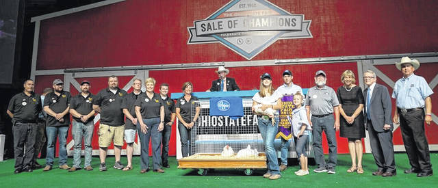 Ava Hester won Grand Champion Meat Chickens, purchased by Gerber Poultry and the Kroger Company for $15,000 (with a cap of $6,000).
